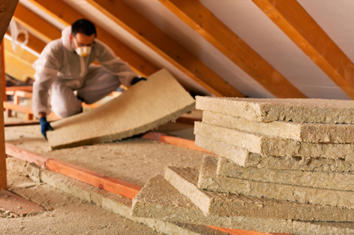 Attic Insulation Being Installed Is A High ROI Home Improvement Projects