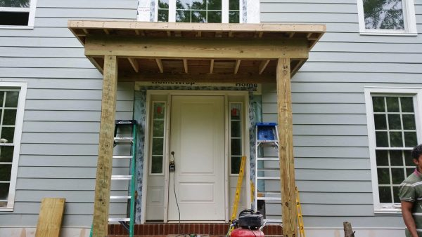 Portico Addition Over Front Door Of Large Grey Home During Construction & Front Door Portico Addition in Annapolis MD - Bohan Contracting