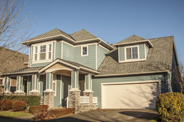 Shingle Roof On Craftsman Style Home with New Siding
